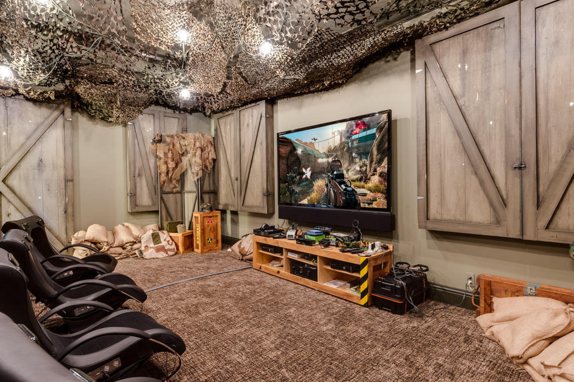 Excess is spelled f l o r i d a looney listing for Video game room design ideas