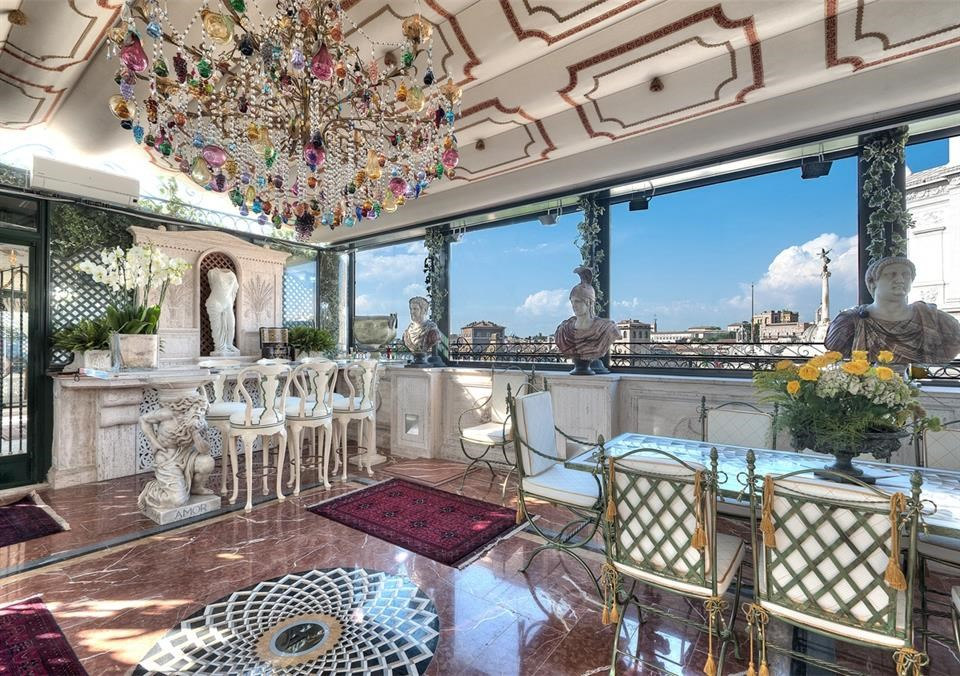 ...to enjoy multi-course dining with penthouse views of central Rome.